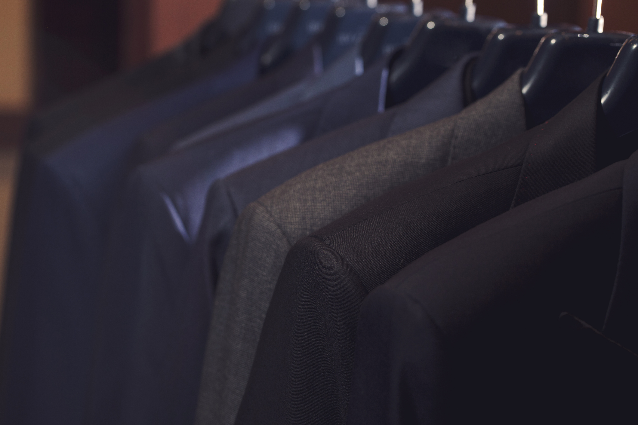 many suits on rack
